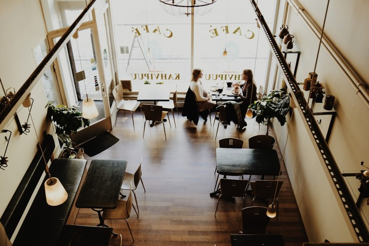 aerial-view-of-cafe-with-girlfriends-sitting-at-table-and-talking_720-1.jpg