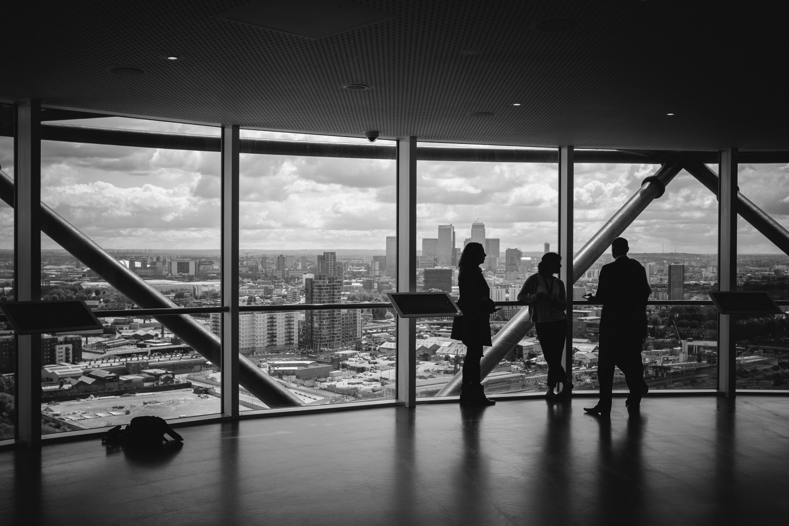 black-and-white-image-of-colleagues-standing-in-office-and-looking-at-city-view-through-window (1).jpg