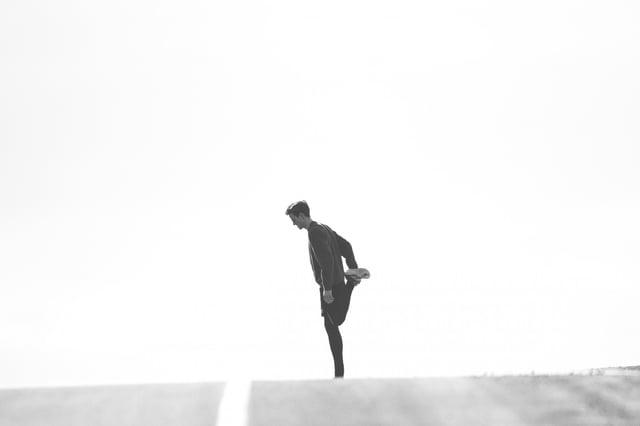 man-stretching-on-road.jpg